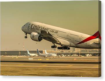 Emirates Airbus 380 In Action Canvas Print by Nick Mares