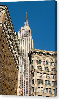 Canvas Print featuring the photograph Empire State Building by Michael Dorn