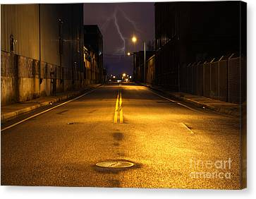 Empty City Street At Night With Lighting Strike Canvas Print by Denis Tangney Jr