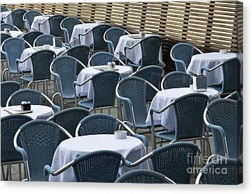 Empty Restaurant Seats And Tables Canvas Print by Sami Sarkis