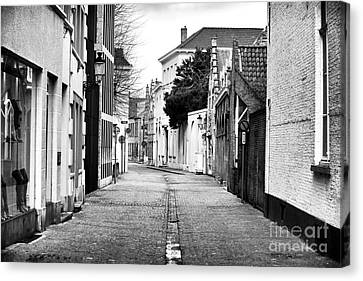 Empty Street In Bruges Canvas Print by John Rizzuto