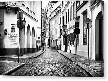 Empty Street In Prague Canvas Print by John Rizzuto
