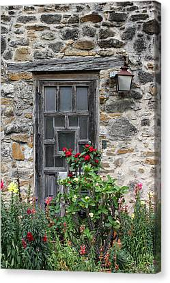 Espada Doorway With Flowers Canvas Print by Mary Bedy