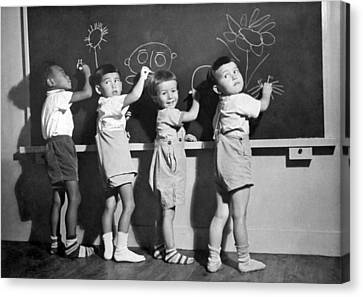 Ethnic Children Draw In School Canvas Print by Underwood Archives