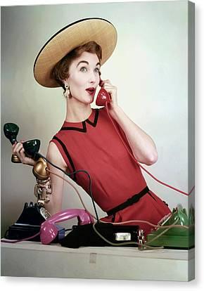 Evelyn Tripp Holding Telephones Canvas Print by Erwin Blumenfeld