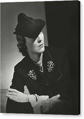 Evelyne Greig Modeling A Military Hat Canvas Print by Horst P. Horst