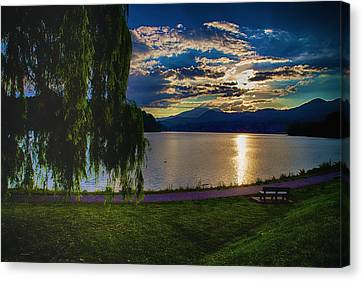 Evening Sun Kisses Lake One Last Time Canvas Print by Dennis Baswell