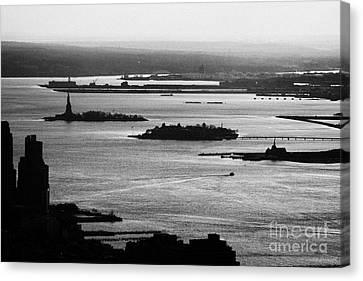 Evening Sunset View Of Liberty And Ellis Island Islands New York City Bay Usa Canvas Print by Joe Fox