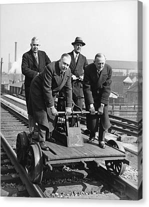 Executives Commute By Handcar Canvas Print by Underwood Archives