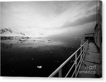 expedition ship covered in snow moored in Fournier Bay on Anvers Island Antarctica Canvas Print by Joe Fox