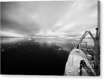 expedition ship with lifeboat covered in snow moored in Fournier Bay on Anvers Island Antarctica Canvas Print by Joe Fox