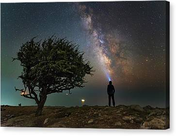 Explorer Looking At The Milky Way Canvas Print by Yuri Zvezdny