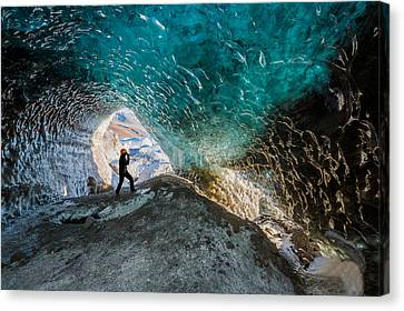 Exploring A Glacial Ice Cave Canvas Print by Panoramic Images