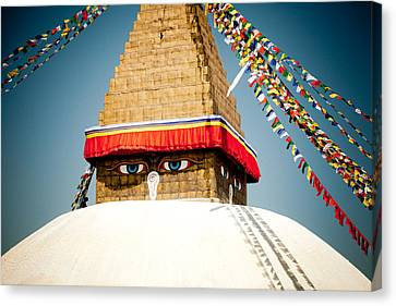Tibetan Buddhism Canvas Print - Eye Of Tibetan Stupa Boudnath And Buddhist Prayer Flags  by Raimond Klavins