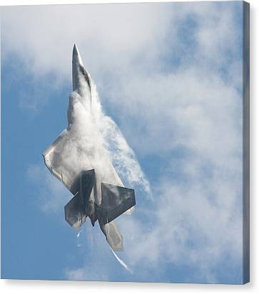 Canvas Print featuring the photograph F-22 Raptor Creates Its Own Cloud Camouflage by Nathan Rupert