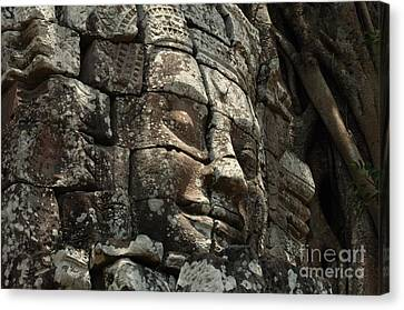 Face At Banyon Ankor Wat Cambodia Canvas Print by Bob Christopher