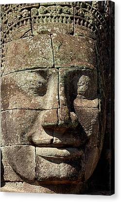 Angkor Thom Canvas Print - Face Thought To Depict Bodhisattva by David Wall