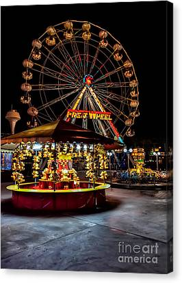 Fairground At Night Canvas Print by Adrian Evans