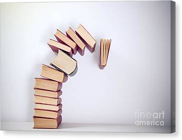 Falling Books Canvas Print by Viktor Pravdica