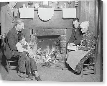 Family By Fireplace At Their Home Canvas Print by Stocktrek Images