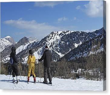 Family On Ski Contemplating Mountains Canvas Print by Sami Sarkis