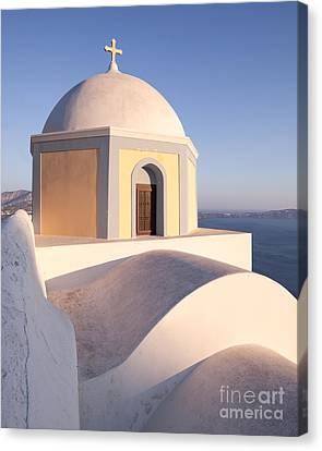 Famous Orthodox Church In Santorini Greece Canvas Print by Matteo Colombo
