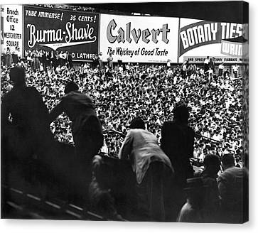 Fans In The Bleachers During A Baseball Game At Yankee Stadium Canvas Print by Underwood Archives