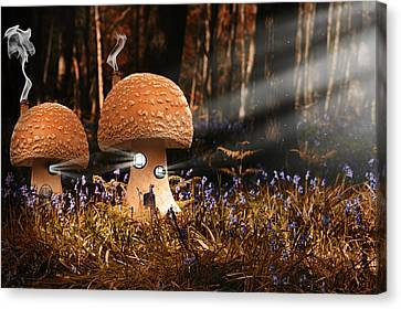 Fantasy Image Of Toadstool Houses In Bluebell Woods Canvas Print by Matthew Gibson