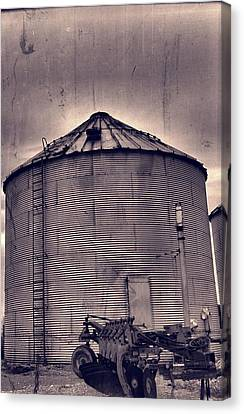Farm Equipment And Silo Canvas Print by Dan Sproul