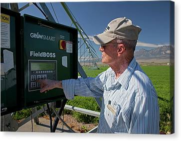 Farmer Adjusting Irrigation Controls Canvas Print by Jim West