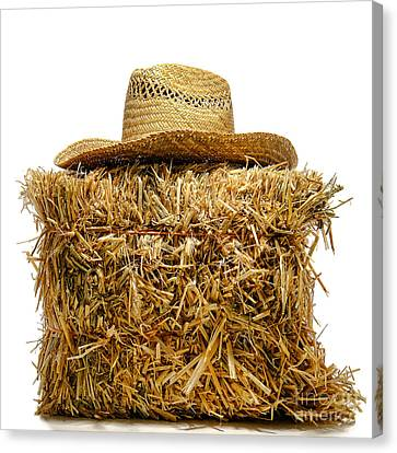 Farmer Hat On Hay Bale Canvas Print by Olivier Le Queinec