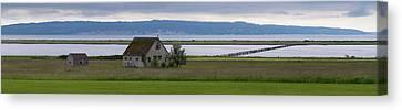 Farmhouse In A Field Along Shore Canvas Print by Panoramic Images