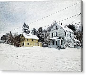 Farmhouses In The Snow Canvas Print by HD Connelly