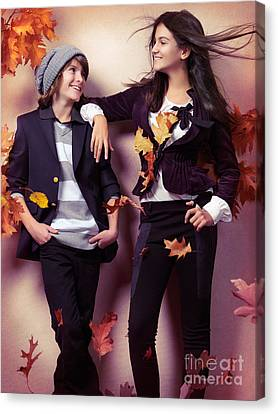Fashionably Dressed Boy And Teenage Girl Under Falling Autumn Le Canvas Print by Oleksiy Maksymenko