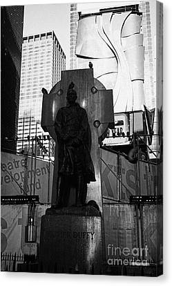 father duffy soldier priest bronze statue with green granite Celtic cross times square new york city Canvas Print by Joe Fox