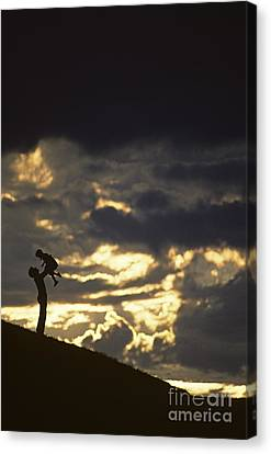 Father Holding Daughter Above His Head Along Hillside Silhouette Canvas Print
