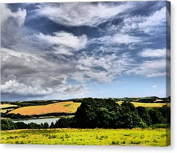 Feather Clouds Over Fields Canvas Print