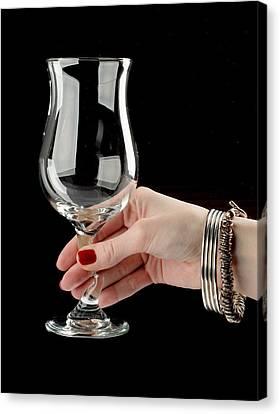 Female Hand Holding Wine Glass Canvas Print by Nikita Buida