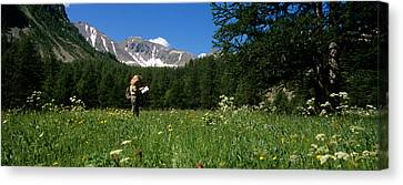 Eco-tourism Canvas Print - Female Hiker Holding A Map by Panoramic Images