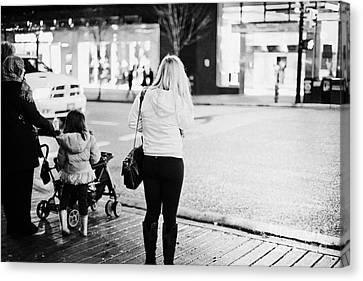 Crosswalk Canvas Print - female shopper waiting to cross the road corner of granville and west georgia streets Vancouver BC C by Joe Fox