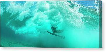 Female Surfer Pushes Under A Wave While Canvas Print
