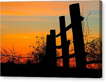 Fence Line With Vibrant Sky Canvas Print by Kirk Strickland