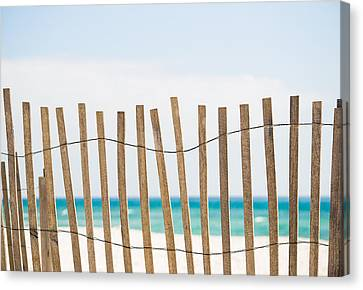 Fence On The Beach Canvas Print by Shelby  Young