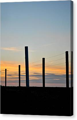 Fence Posts At Sunset Canvas Print by Wayne King