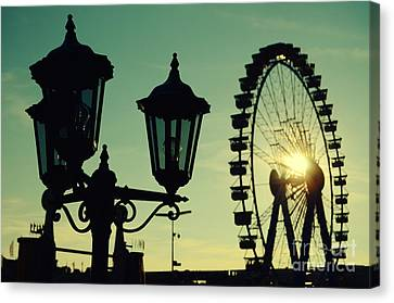 Ferris Wheel At Sunst At The Octoberfest In Munich Canvas Print by Sabine Jacobs