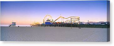 Ferris Wheel Lit Up At Dusk, Santa Canvas Print by Panoramic Images