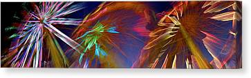 Ferris Wheel Spinning At Night Canvas Print by Panoramic Images