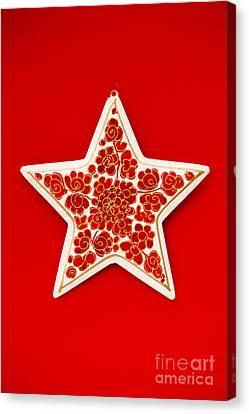 Festive Star Canvas Print by Anne Gilbert
