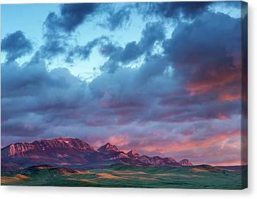Fiery Sunrise Light Strike Choteau Canvas Print by Chuck Haney