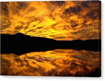 Fiery Sunrise Over Medicine Lake Canvas Print by Rich Rauenzahn